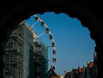 Ferris wheel in the city of Gdansk. Shot through the arch stock image