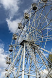Ferris wheel in the city park. Autumn. Ferris wheel against the background of the blue sky in the autumn park Stock Images