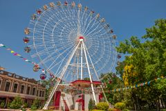 Ferris wheel in city park Stock Images