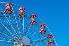 Ferris wheel with clear blue sky. Photo taken in Herastrau Park in Bucharest, Romania Stock Photography