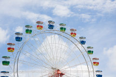 Ferris wheel with clouds and blue sky. Ferris wheel with blue sky and wispy clouds Stock Image