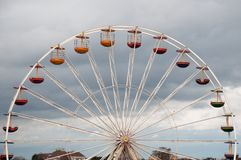 Ferris Wheel. On the cloudy background Stock Photo