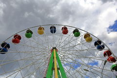 Ferris wheel on a cloudy day. Ferris wheel in amusement park in cloudy weather this summer Royalty Free Stock Photo