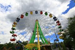 Ferris wheel on a cloudy day. Ferris wheel in amusement park in cloudy weather this summer Stock Image