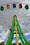 Ferris wheel on a cloudy day. Ferris wheel in amusement park in cloudy weather this summer Royalty Free Stock Image