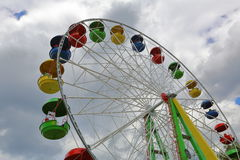 Ferris wheel on a cloudy day. Ferris wheel in amusement park in cloudy weather this summer Royalty Free Stock Photography