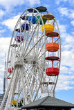Ferris wheel and cloudy sky at mount Tibidabo in Barcelona, Spain stock images