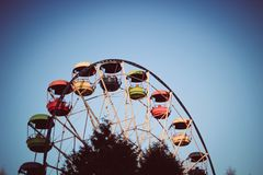 Ferris wheel with color booths. Amusement park Stock Photography