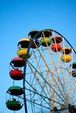 Ferris wheel with color booths, amusement park. View from the top Stock Photos