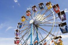 Ferris Wheel. Colorful ferris wheel against blue sky. Horizontal Stock Image