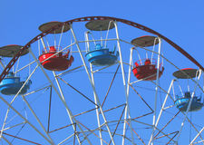 Ferris wheel. Colorful booths Ferris wheel on the background of blue sky Stock Photo