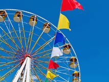 Ferris wheel and colorful flags Royalty Free Stock Image