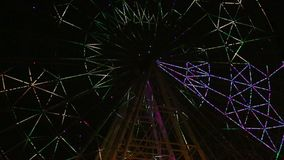 A Ferris wheel colorful light show movie stock video