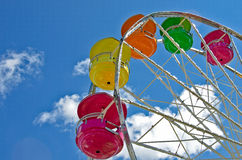Ferris wheel with colorful pods Stock Images