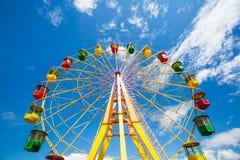 Ferris wheel. Colourful ferris wheel on blue sky Stock Image