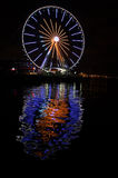 Ferris Wheel. Colourful reflection in water in Seattle WA Stock Image