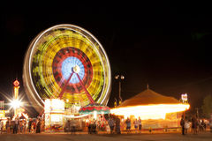 Ferris Wheel at County Fair. Blurred lights and motion at night at the county fair Royalty Free Stock Images