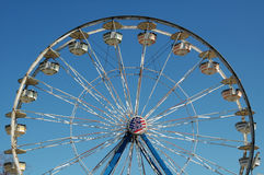 Ferris Wheel at County Fair. Tall ferris wheel at a county fair on a clear day royalty free stock photography
