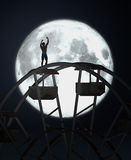 Ferris wheel. 3d illustration of a Ferris wheel, moon and crazy man Stock Images