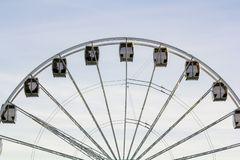 Ferris wheel against blue sky stock photography