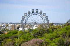 Ferris wheel. Decorating the amazing background of Cordoba cityscape taken from Sarmiento park royalty free stock photography