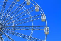 Ferris wheel. Detail of a ferris wheel on blue sky background Stock Image