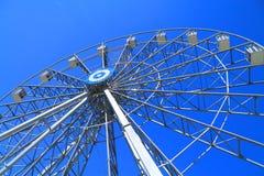 Ferris wheel. Detail of a ferris wheel on blue sky background Stock Photos