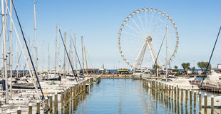 Ferris Wheel at the Dock of Rimini, Italy. Perfect frontal view of the ferris wheel in the brand new dock of Rimini, Italy Stock Photo