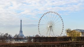 The ferris wheel and the Eiffel Tower in Paris Stock Image