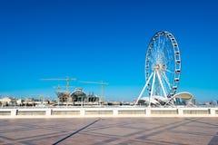 Ferris wheel on the embankment Stock Photography