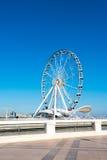 Ferris wheel on the embankment Stock Photos
