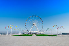 Ferris wheel on the embankment Stock Images