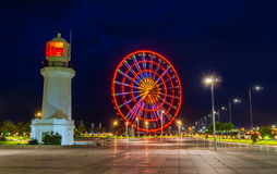 The ferris wheel in evening lights Royalty Free Stock Photo