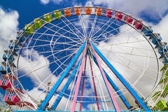 A ferris wheel on a fair. Attraction ferris wheel in amusement park Royalty Free Stock Photo