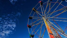 Ferris Wheel / Fairground ride with deep blue sky royalty free stock photography