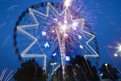 Ferris Wheel and fireworks at night Stock Photo