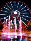 Ferris wheel and fountain Stock Photos