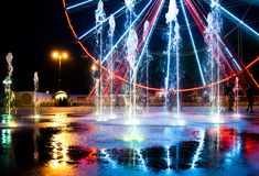Ferris wheel and fountain Stock Image