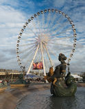 The Ferris wheel and fountains of Place de la Concorde, Paris, France stock photos