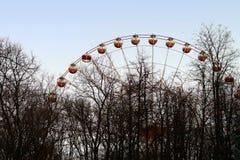 Ferris wheel fragment through the Trees Royalty Free Stock Photography