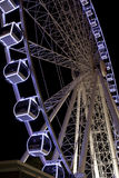 Ferris Wheel glowing at night Stock Photography