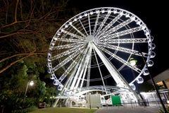 Ferris Wheel glowing at night Stock Image