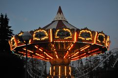 The Ferris wheel glows in the park in the evening. The Ferris wheel glows in the park Royalty Free Stock Photos