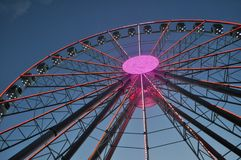 The Ferris wheel glows in the park in the evening. The Ferris wheel glows in the park Royalty Free Stock Images