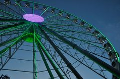 The Ferris wheel glows in the park in the evening. The Ferris wheel glows in the park Royalty Free Stock Photo