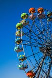 Ferris wheel with gondola in the form of a balloon. Royalty Free Stock Photo