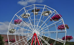 Ferris wheel with gondolas filled with flowers Royalty Free Stock Image