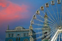 The Ferris wheel in the historical part of Kyiv on the Kontraktova Square on Podol in the evening, Kyiv. Ukraine royalty free stock photography