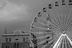 The Ferris wheel in the historical part of Kyiv on the Kontraktova Square on Podol in the evening, Kyiv. Ukraine. Black and white filter royalty free stock image