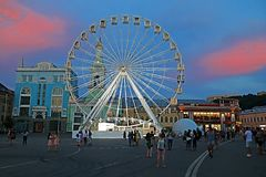The Ferris wheel in the historical part of Kyiv on the Kontraktova Square on Podol in the evening, Kyiv